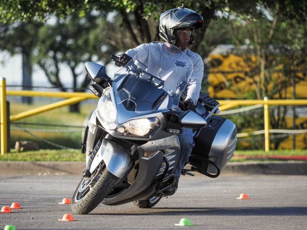 instructor riding a cone pattern